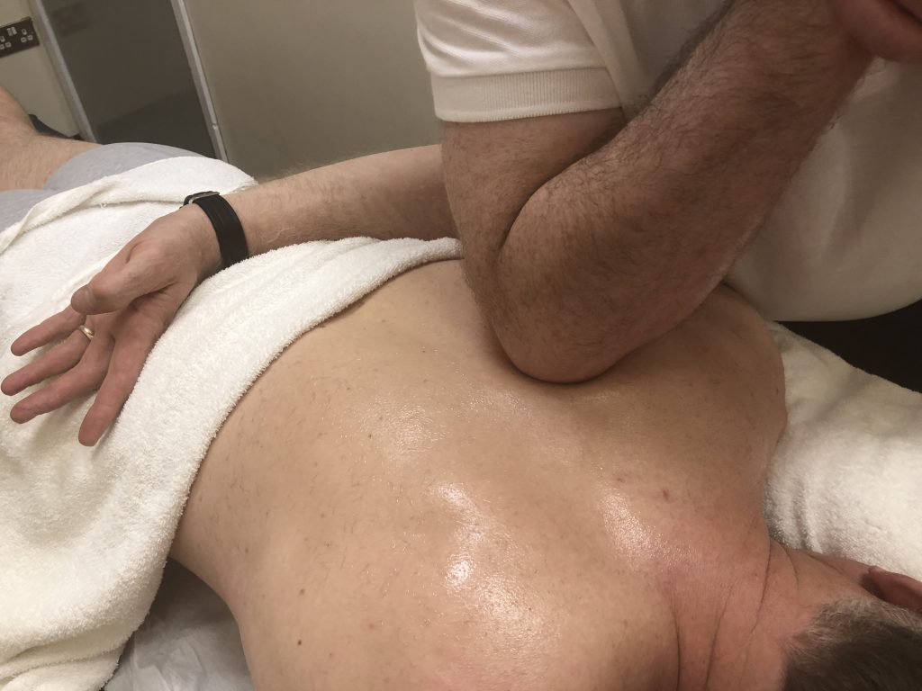 Adrian Gee Sports Massage on Back using Elbow Pressure